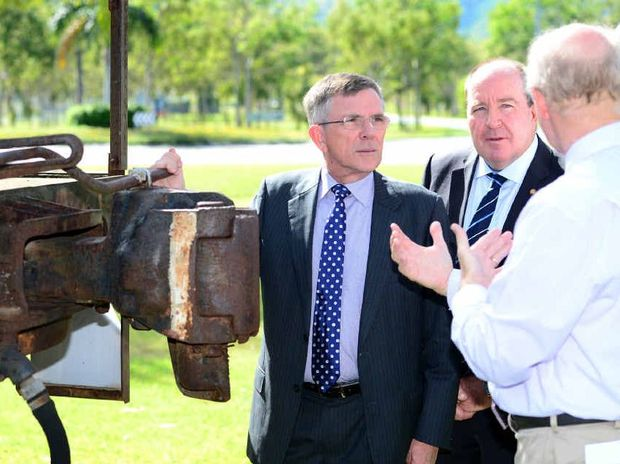 TRAINING WHEELS: Minister Ian Walker talks with Professor Peter Wolfs at CQUniversity and Keppel MP Bruce Young.