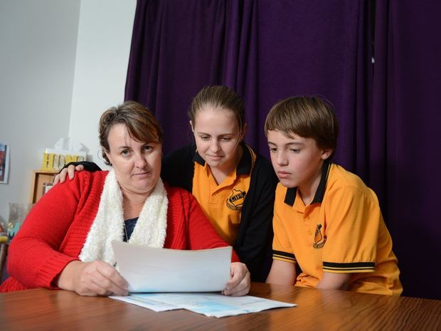 Wendy Briggs and her children, Emily Briggs and Codey Briggs. Wendy is a single mum with three kids, two of whom have autism, says the budget is going to make things very hard for her.