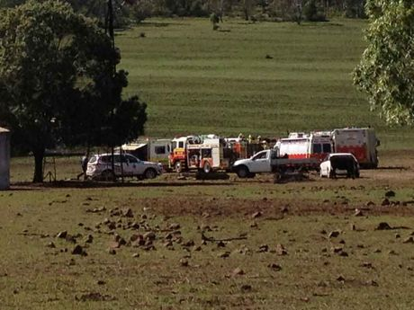 Emergency services at a Nobby property where a man has been seriously injured after he was trapped in a feed bin.