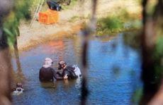 Police divers search Lake Awoonga near Gladstone as part of an investigation into the murder of Rockhampton pair Robert Martinez and Chantal Barnett.
