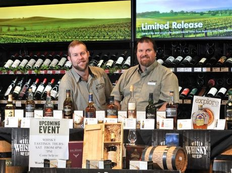 Dan Murphy's Gladstone customer experience manager Ryan Lobegeier (left) and store manager Darren Oakey are excited to celebrate World Whisky Day by hosting free in-store whisky tastings.