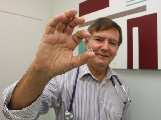 HEALTH: Dr Jeff Tarr holds a plastibell, which is designed for circumcising infant males.