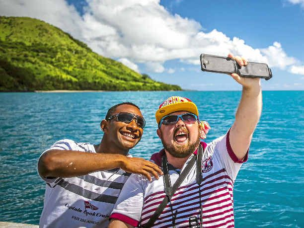 SMILE PLEASE: First-time traveller Griffith Thomas enjoys another one of life's firsts by taking a selfie with Captain Cook Cruises crewman Patrick while visiting Vuaqava Island.