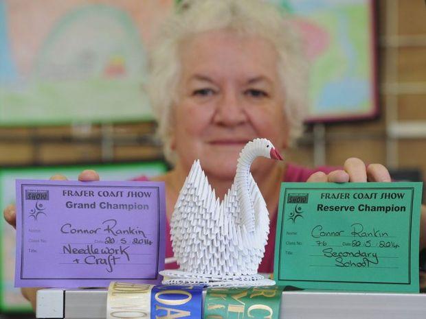 Fraser Coast Show chief steward Dawn Gomersall with 12-year-old Connor Rankin's winning paper swan.