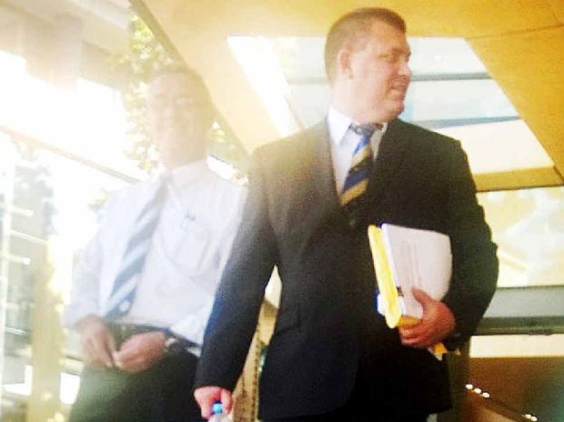 CUP CLASH: Logan detective Martin Heath Hunter (right) fronts an Ipswich court.