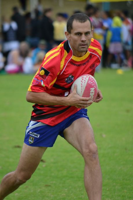 Toowoomba Hospital critical care unit nurse unit manager Chris Hombsch runs the ball during the Queensland Health Community Cup.