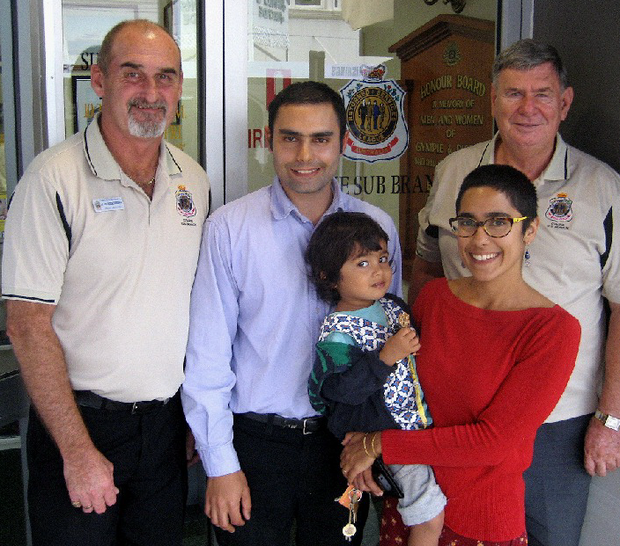 The Gympie RSL's Alan Birkenhead (left) and medal refurbisher Greg McGuire (right) with the family of serviceman Ivor Haines: (from second left) Nicholas, Mateo Abed, and Yasmin Haines.