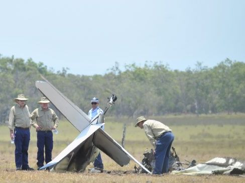 Australian Transport Safety Bureau investigators at the scene the day after the plane crash.