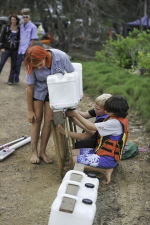 Kirk Kelly, 9, from Gin Gin designed a kayak for the RE/MAX Baffle Creek Raft Race and Baffle Creek siblings Katy Cherry, 12, and James Cherry, 11, provided assistance in assembly and paddling on the day.