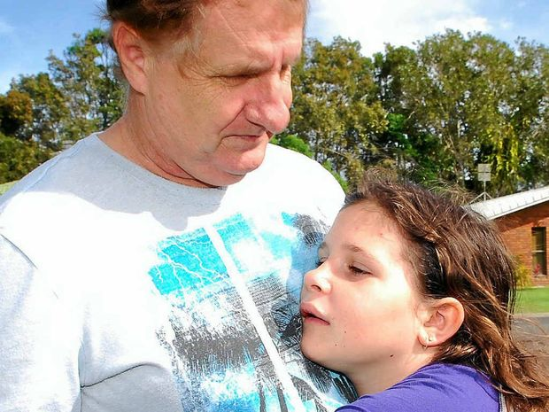 KNOCKED DOWN: Terry Trussler and his daughter Ashleigh, 11, had a lucky escape from serious injury.