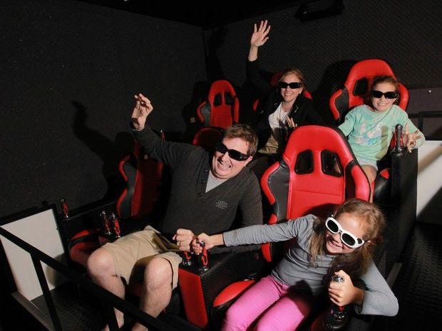 The Lopez family from Brisbane, Dale and Nerida and their daughters Elise, 8, and Claire, 10, try out the new 7D Cinema on the Mooloolaba Esplanade. Photo: Brett Wortman / Sunshine Coast Daily