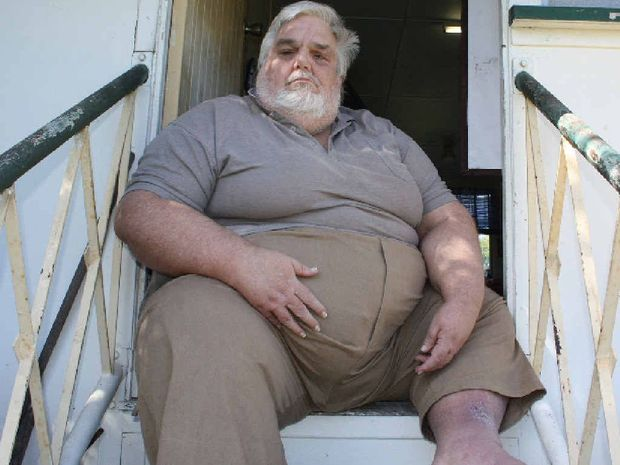 Koongal resident Joel Adams sits in his doorway pondering his future after his father's house is sold.