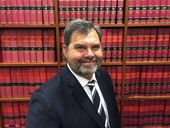 THE man about to take on Queensland's highest judiciary position hopes his background can help reduce the disconnect people feel from the court system.
