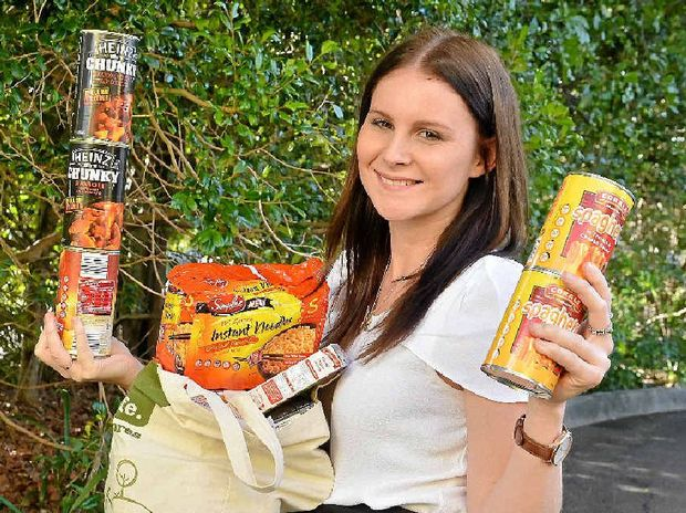 BIG HELP: Emily Haynes from the Sunshine Coast Daily checks some of the food left for the homeless.