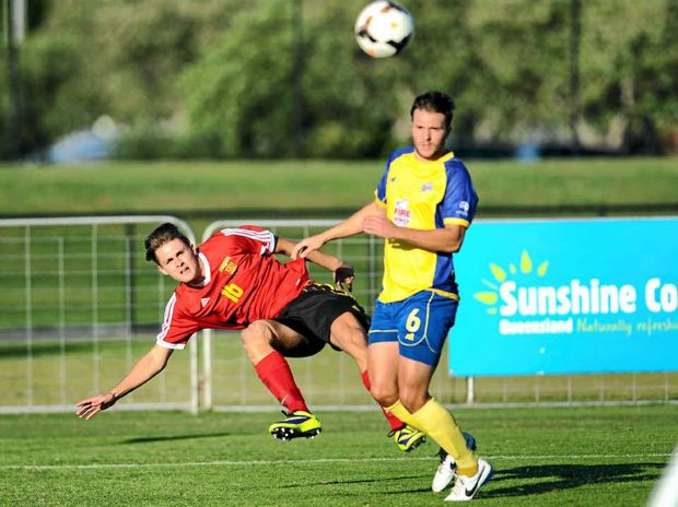 FIRING UP: The Fire's Jakob Polluck fires a cross in the match against the Brisbane Strikers at Stockland Park.