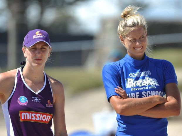 (left) Clare McMeniman and Laura Geitz from Qld Firebirds netball at surfing training at Alex Headland as part of a pre-season camp on the Sunshine Coast.