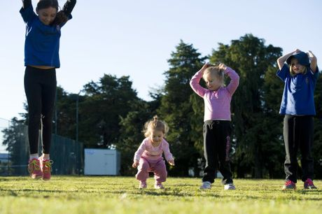 Two-year-old Carlie Johnson (centre, left) does burpees with (from left) Lauren Thornton, Brooke Johnson and May Fleming at a kids boot camp run by Terri Thornton of Healthy Body Solutions, Tuesday, June 17, 2014. Photo Kevin Farmer / The Chronicle