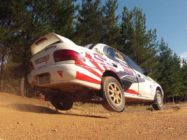 RIDING HIGH: Jay Davidson launches through the Canberra forest earlier this year in his Subaru WRX Impreza