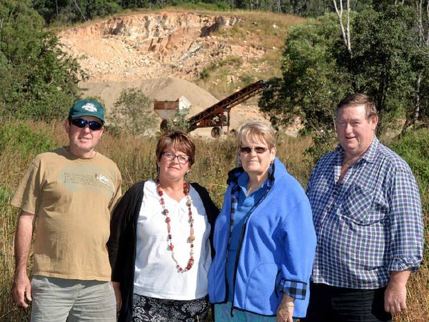 Chris and Jo Langley (left) and Sylvia and Reg Bouskill with the quarry near Eton behind them. They are standing at a neighbour's fence, which backs onto Sutton's Quarry.