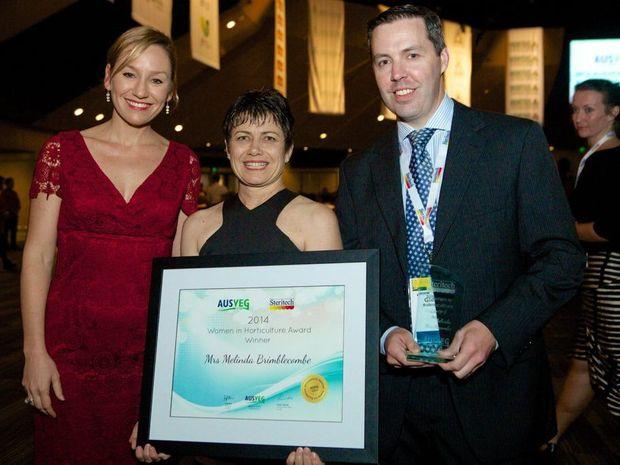 Senator Larissa Waters (left) and Steritech's Glenn Robinson congratulate Lockyer Valley grower Melinda Brimblecombe (centre).