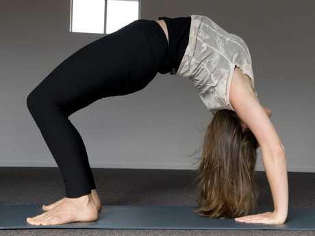 Nicole Loxley teaches hot yoga.