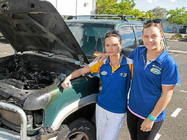 DEVASTATED: Swim instructor Anna Baque, left, with her employer Kristy Perkins and her uninsured and ruined car.