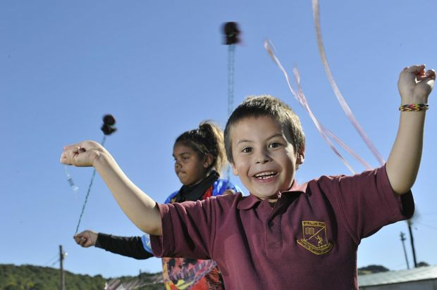 Greg Cummins (6), of Lismore, and Caroline Bradshaw (11), of Alstonville, have fun at the NAIDOC celebrations at the Lismore Showgrounds. Photo Marc Stapelberg / The Northern Star