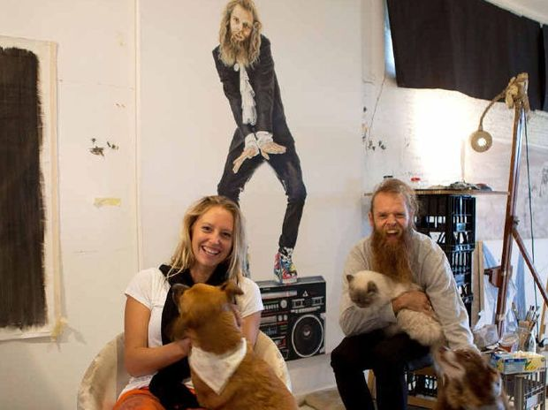 DIFFERENT STROKES: Byron Bay artist Liesel Arden with Tommy Franklin and her Archibald Prize entry in the background.