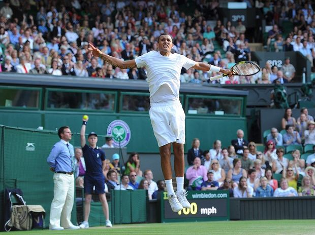 Australian teenager Nick Kyrgios jumps into the air after his Fourth round victory against Rafael Nadal at Wimbledon.