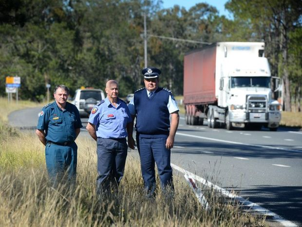 DRIVE SAFELY: Gympie ambulance officer Wayne Sachs, Fire and Rescue Stiion oficer.... and Gympie police head Jon Lewis are urging motorists to plan their trrips to stay alive. Photo Craig Warhurst / The Gympie Times