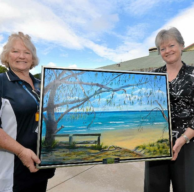 ART FROM THE HEART: Childers Hospital divisional therapist Lyn Dobbs and director of nursing Susan Parks are grateful for the donation of a painting by the Childers Catholic Women's League.