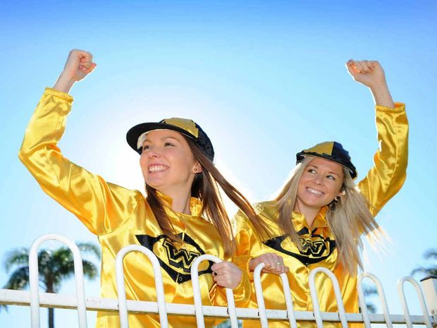WESTLAWN CUP DAY is here at last, heralding the start of the 2014 Grafton July Racing Carnival. Sarah Templeton and Nikki Cousemacker are trackside in fashionable gold and black. Photo: Leigh Jensen