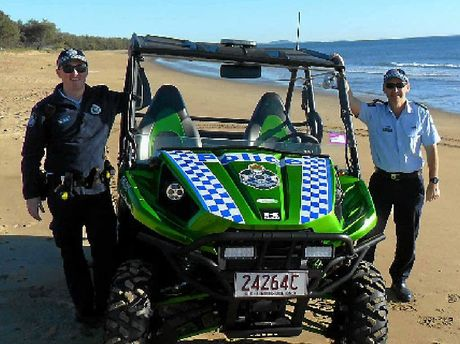 BEACH BEAT: Constable Jack Casey and Senior Sergeant Tony Poli with the new ATV at Tannum Beach.