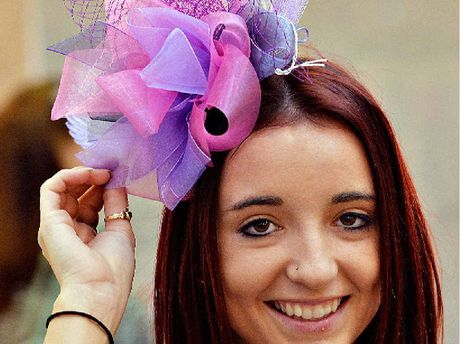 Whitney Schaper makes any fascinator look good.