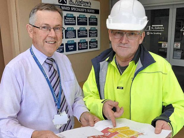 St Andrew's Hospital CEO Ray Fairweather (left) and engineering services manager Kenn Zerner discuss expansion plans for the hospital's surgical facilities.