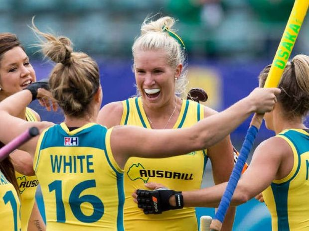 The Hockeyroos close in on Jodie Kenny after a goal against the Netherlands in The Hague at last month's Hockey World Cup.