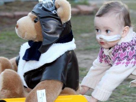 Taleah Scott plays with her Careflight bear