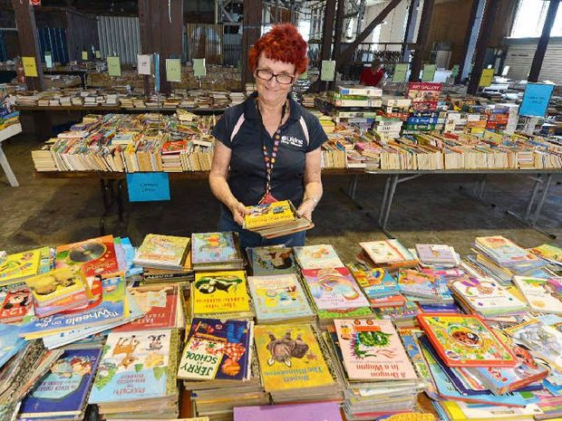 Lifeline volunteer Lyn Lewis is busy stacking and sorting about 30,000 books for the Mackay Lifeline Bookfest, which opens today at Paxtons Warehouse, River St.
