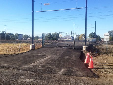 OUT OF ORDER?:Rising Sun Hotel owner Darren Pettiford and councillor David Pahlke wonder why this sealed crossing only a few hundred metres from the main rail crossing can't be used.