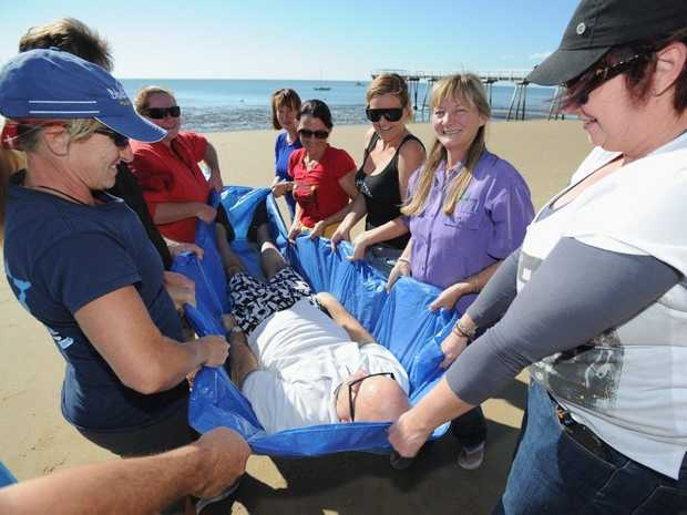 Whale first-aid workshop at Torquay Beach, presented by Jeannie Lawson, shows how to carry a whale or dolphin to the waters edge.