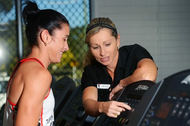 IN TRAINING: YMCA fitness manager Sherry Ey gives Jodie Wilson and others some training tips ahead of the Cane2Coral. Photo: Max Fleet / NewsMail