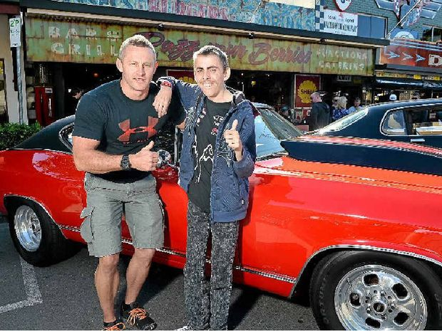 RIDE OF HIS LIFE: Joshua Charrington-Miletic checks out a 1968 Chevelle owned by Scott Hipwell (left) before his trip from Maleny to Palmwoods.