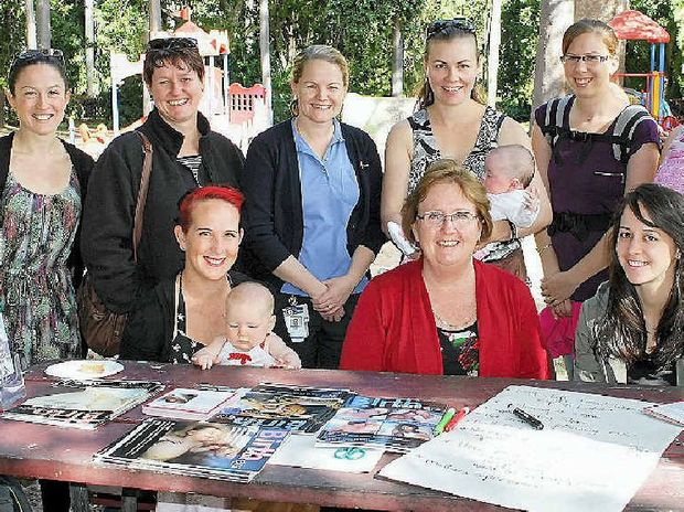CARING FOR MUMS: (Seated) Anjeliza Wanstall (with Eliza), Tracey Hynes, Yvette Walters, (standing) Tabitha Humphreys, Julie Snee, Liz Clare, Amelia Herring (with Sophia) and Caitlin Wiersma discuss Rockhampton Hospital's maternity care.