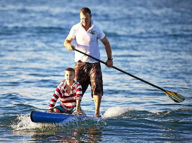 LONG PADDLE: Andy Owen and 12-year-old leukemia sufferer Xavier Slezak.