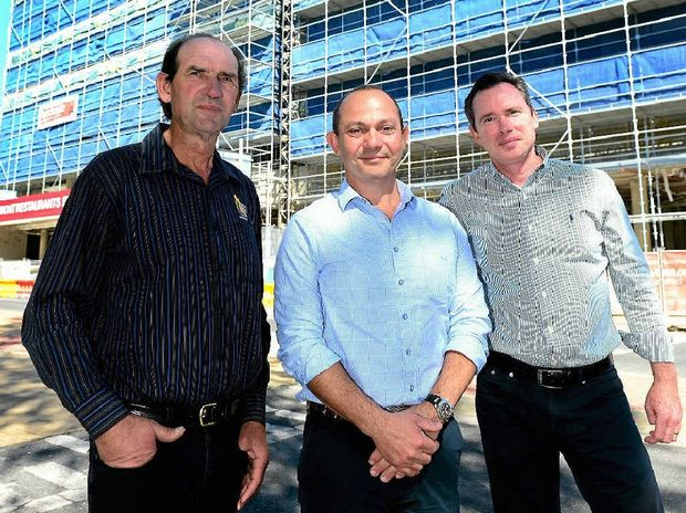 MOVING BASE: Development partners Wayne Riddell and Andrew Beaumont with Pacino's owner Guy Pilcher (centre) outside the Empire.