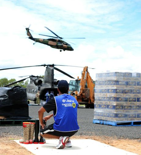 A Lifeline worker helps in emergency relief during the 2011 floods. Photo Contributed