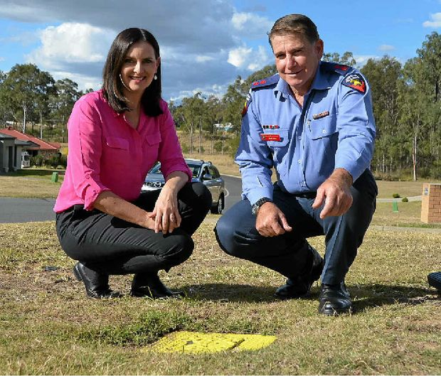 SAVING LIVES: Michelle Hull from Queensland Urban Utilities with Gatton Fire Station Captain Geoff Dixon with one of the Lockyer Valley's almost 2000 fire hydrants.