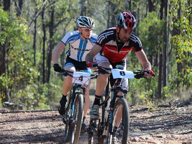 IN FRONT: Toby Boylan leads series leader Michael England on the first lap in expert mens race in round three of the XCO series. Photo Contributed