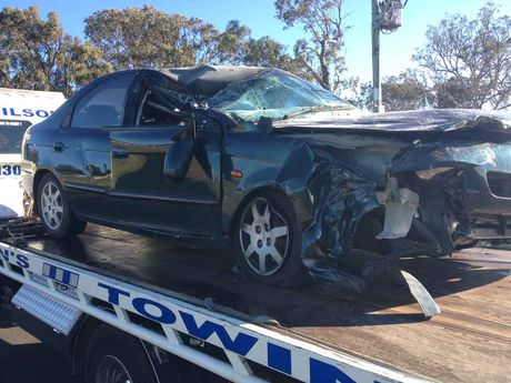 The car involved in a collision with a truck on the Gore Hwy this morning.