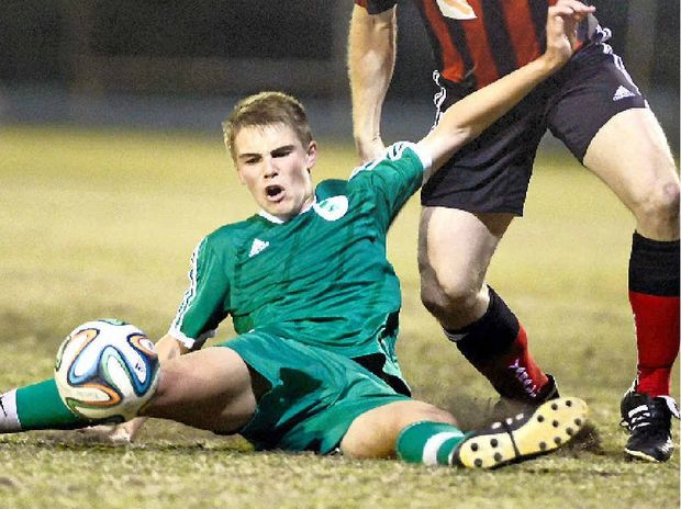 Clinton's Anthony Cobb is challenged by Yaralla's Ben Smith during their sides' 3-3 battle on Saturday.